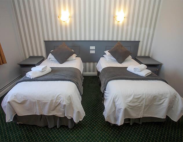|The Bells twin room beds